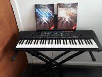 Yamaha keyboard with accessories
