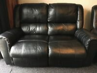 2 Black Leather Habitat two seater reclining sofa's