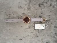 Women's Rose gold Olivia Burton strap. Brown face with grey leather strap