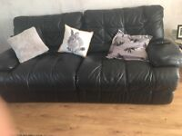 3 seater and 2 seater black leather couch. Free to anyone who can collect.