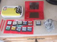 red nintendo dsi with liverpool case and games