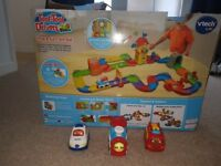2 sets -Toot Toot chug and go train set with train and deluxe Toot Toot set with emergency vehicles