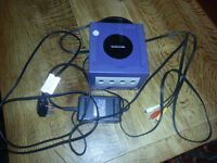 Nintendo Gamecube with power and tv cables. Perfect working order. Purple/Indigo.