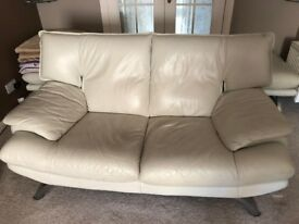 Leather Suite Three Seater, Two Seater with Leather Pouffe, cream coloured in very good condition.