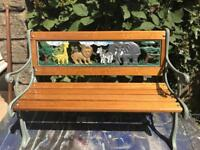 Child's hardwood and metal end seat with African animal design