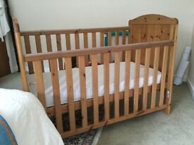 Pine dropped side cot from toysRus. Mattress if required.
