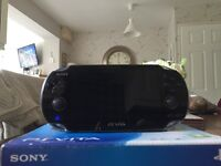 PlayStation Vita console, with 4 PlayStation Vita games included along with memory card