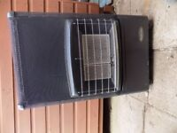 gas fire with bottle in good condition due to being stored in a shed