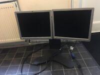 2 x Hewlett Packard PC monitors 1x Ergotron adjustable double display stand
