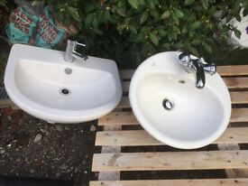 2 good quality and nice condition bathroom sinks with taps and waste