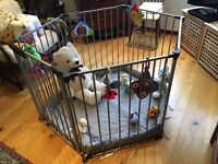 Spacious playpen with grey playmat