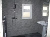 wash basin with taps,shower,heated towel rail