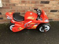 Children's 16 inch bike and red motorbike ride on