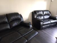 Nearly new sofa's black leather