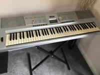 Yamaha portable grand piano DGX-205