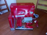 Ninendo wii with games and extras in Red