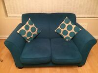 Teal settee 2 seater and 3 seater.