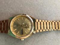 Automatic golden wrist watch