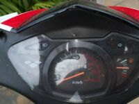 Economical ped with top box & helmet