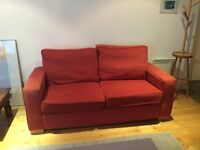 Free two-seater sofa for whoever picks it up first