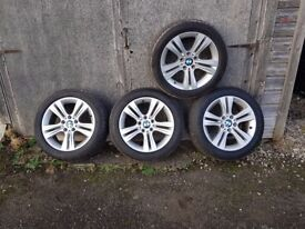 A set of genuine bmw alloys with tyres