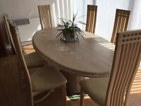 Large marble dinning table and six chairs .