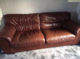 Three an two seater brown leather sofa