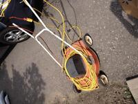 Electric lawn mower. Dated but works great!
