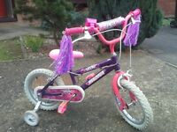 Girl bike . Bell and tassels, with Stabilisers