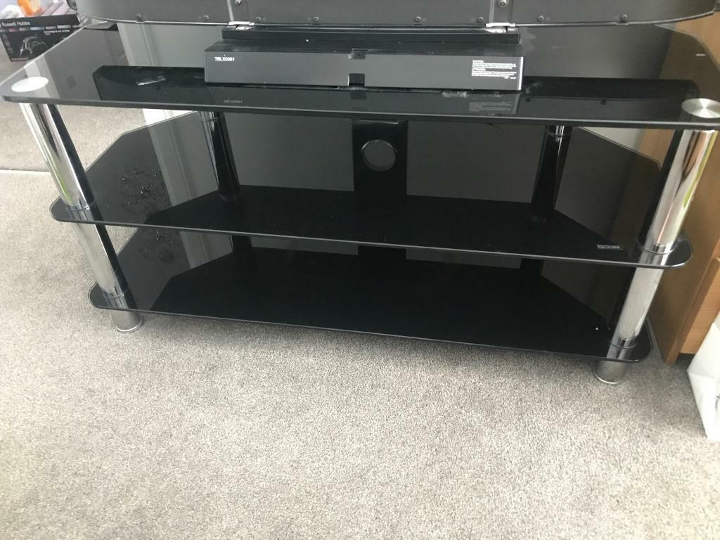Black glass TV standin Bishopbriggs, Glasgow - 3 tier excellent condition black glass TV stand Black glass TV stand . Posted by Annice in TV, DVD & VCR Accessories, TV Mounts & Stands in Bishopbriggs. 24 June 2018
