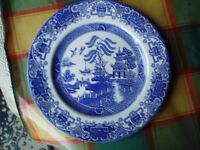 Old willow pattern dinner plates