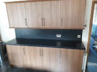 Kitchen doors, handles, panels, wall units, shelves, cornice and kickboards