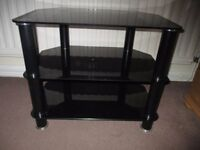 Small black and silver tv stand
