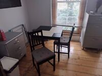 IKEA dining table and two chairs for sale