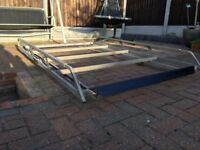 Galvanised roof rack with ladder rollers
