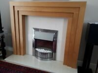 Electric coal effect fire, fire surround and base polished stone and polished wood mantel