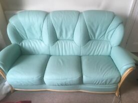 Three seater leather sofa plus two armchairs and a footstool in green. Great condition