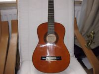 Child's Valencia Guitar, plays well, all strings, beautiful condition, 1/2 size. with case.
