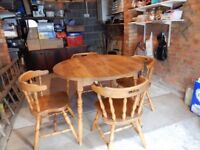 Wooden Formica (laminated) table and 4 chairs