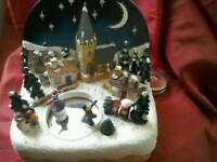 Chtistmas ice skaters decorative scene.