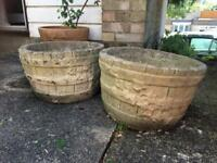 Two matching stone garden planters