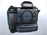 Nikon F100 SLR 35mm Film Camera Body with MB-15 Battery pack attached.