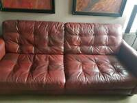4 seater leather sofa with matching storage footsto
