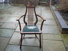 An unusual open side arm chair with lyre back.