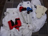 Karate Suits (Various Sizes) with also leg & hand pads.