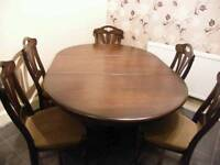 Extending dining table & six chair's