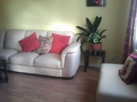 LEATHER CORNER SOFA AND FOOT STOOL - A VERY RARE FIND - BEAUTIFUL CONDITION IN CREAM