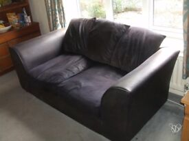 black leatherette 2 seater sofa in good condition