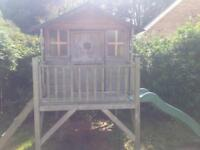 wooden garden play house with slide