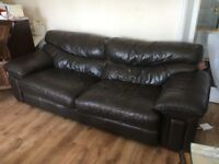 Free to collector- well worn brown leather sofa